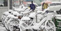 Pekín amanece cubierta de nieve provocada de forma artificial por el Ejército